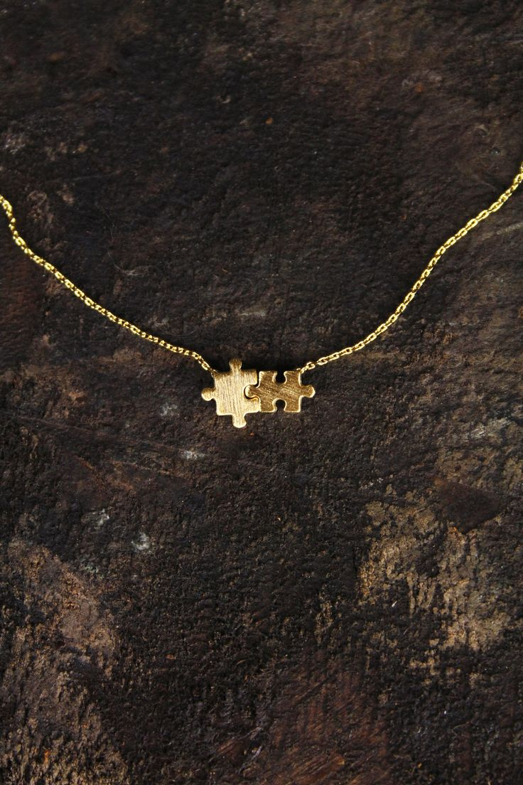 Our cute delicate necklace features tiny linked puzzle pieces. · Delicate Gold Finish · Puzzle Pieces Charm · Imported