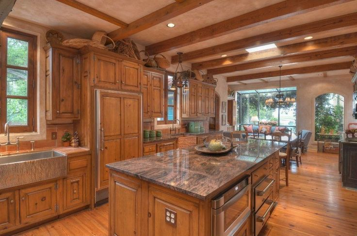 Mediterranean Kitchen with Skylight, Inset cabinets, MS international - Crema Bordeaux, Raised panel, Exposed beam, One-wall