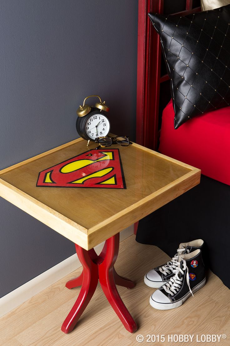 We transformed this humble tray table into customized bedroom furniture with help from a tin superhero sign and some clear casting resin.