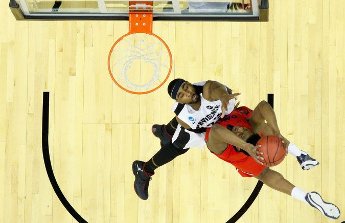 Dayton Upsets Providence in Front of Raucous Ohio Crowd - Dayton's Dyshawn Pierre rising for a dunk against LaDontae Henton of Providence. Pierre led the Flyers with 20 points. NYTimes.com
