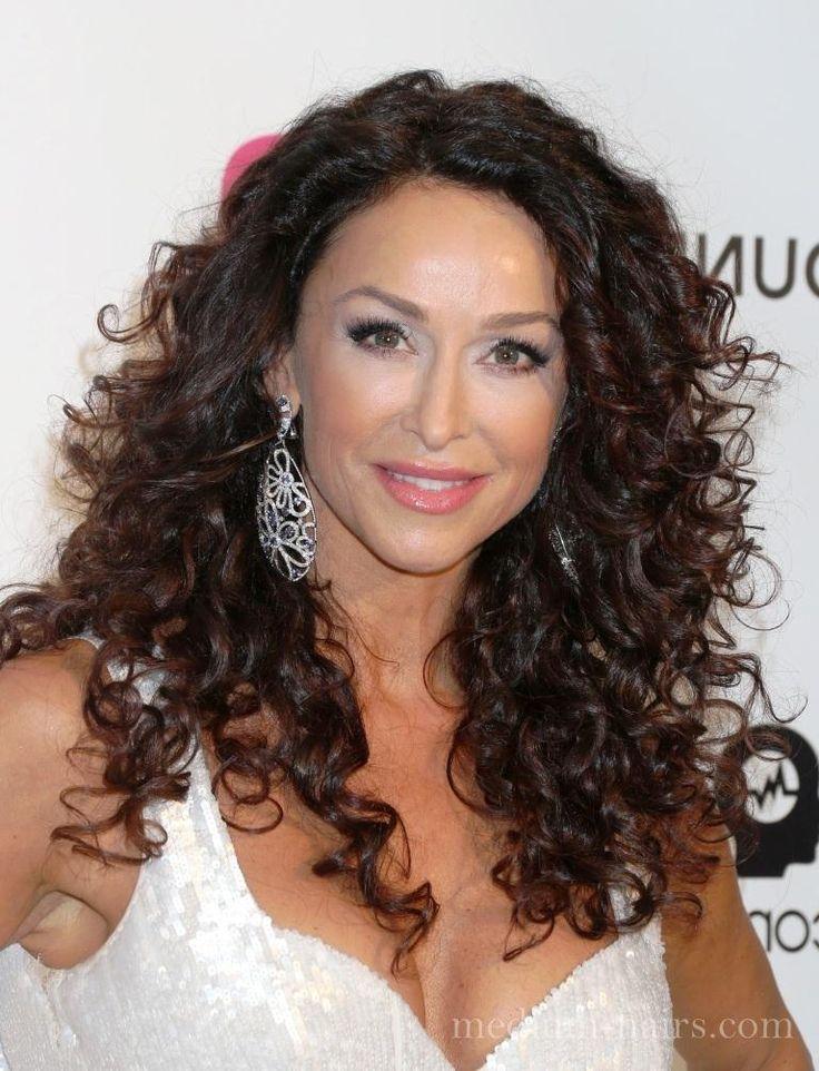sofia milos mid length curly hair