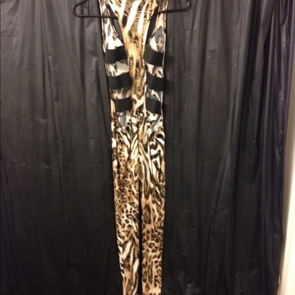 Cheetah bodysuit just like Nicki Minaj wore.. Black n brown Cheetah print bodysuit. just like Nikki Minaj wore in her bees in the trap video.  ▶ No trading only for sale. please make offers in offer section. ◀️  Other