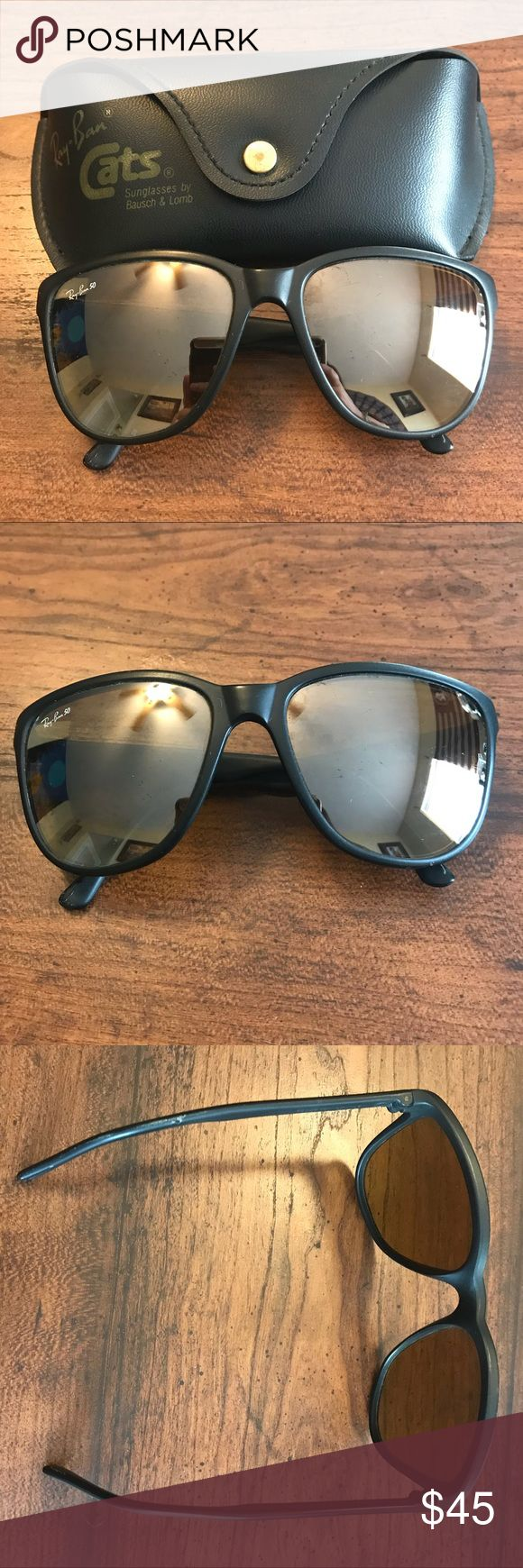 "Ray-Ban ""Cats"" Vintage Sunglasses Ray-ban vintage sunglasses with black rims and slightly golden reflective lenses. Case is included. In good condition, but they do have some slight scratches. A little bit bigger than modern Wayfarer Ray-bans Ray-Ban Accessories Sunglasses"