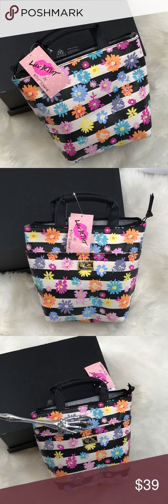 """BETSEY Johnson Daisy lunch bag NWT  BETSEY Johnson Insulated lunch mini tote with all over black & white stripe & colorful Daisies, front slip pocket, Luv Betsey logo plaque. Top handles 2"""" drop. Signature golden hardware. Zipper closure. Insulted interior.                                 9 H x 7.5""""/10"""" W x 5"""" D.                                                                           II  NEW with tags   Bundle for a discount       5 star ratings      Fast shipper     100% authentic…"""
