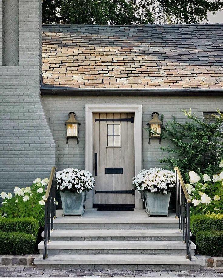 Enchanting Grey Brick Exterior With Plank Wood Door Curbappeal