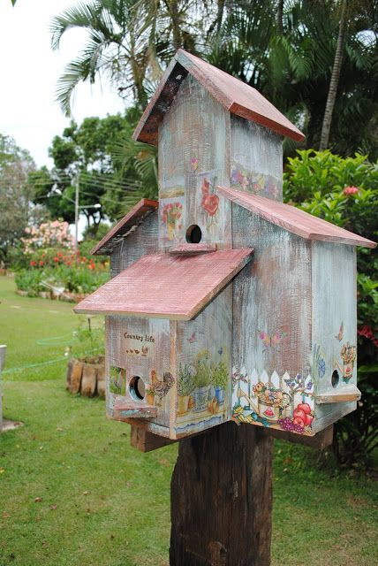 Birdhouse made from reclaimed wood and then decoupaged.