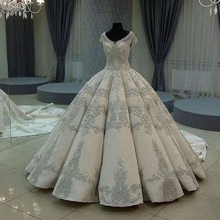 This slightly off the shoulder wedding gown has short cap sleeves. The open neckline flatters the traditional ballgown style. If you are searching for Princess #weddingdresses this is one to consider. We can make ornate designs for an affordable cost. As US dressmakers we can also make close #replicas of any designer gown for you if the original is out of your price range. Our version will have the same style but just cost less. Get pricing and more info from us at DARIUS BRIDAL.