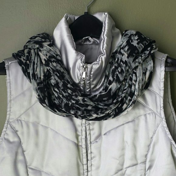 Silver Vest Lightweight vest for layering indoors or outdoors.  Gently worn. No sign of wear, tear or stains. Jackets & Coats Vests