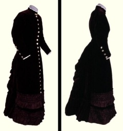 1887 Children's/Teenage Dress - Deep maroon velvet dress.  Fitted bodice with long sleeves and high neck.  Skirt with simple bustle effect and the hem finished with deep frill of pleated velvet.  The dress is fastened with 'silver' buttons down the front and at the cuffs.