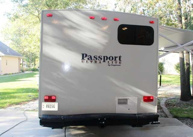 2010 Used Keystone Passport 195RB Travel Trailer in Indiana IN.Recreational Vehicle, rv, Northwest Indiana. Purchased new; only used 9 weekends (too busy); kept in very clean garage at all times; is in excellent shape (only used by elderly couple). LIKE NEW! Dry weight is 3880 lbs., Features: exterior gas cooking stove; pass- through large storage area; exterior shower; ordered closet area by door instead of bench seat; powered awning. Changes/Additions: added extra LP connection for outside…