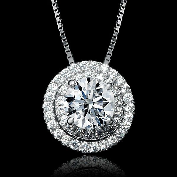 .83 CTW Double Halo Round Diamond Pendant Necklace.  Find out more about our wholesale diamond jewelry at http://diamondexchangedallas.com