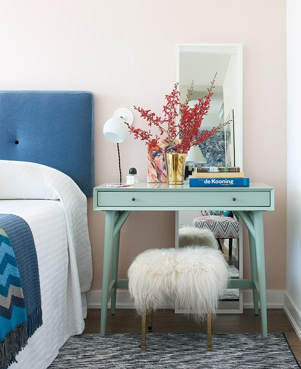 Luxe Eclectic Bedroom | A blue mohair-covered headboard pops against blush-coloured silk wallpaper. The mid-century modern–inspired side table doubles as a makeup stand, complete with a welcoming sheepskin-covered stool. A tall, leaning mirror reflects light and adds a sense of space. | #findyourbalance #tetley #bedroom #interiordesign