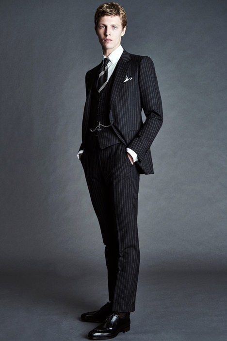 This Tom Ford pin striped suit is heavily influenced by the 1890's menswear. The lapels are triangular and the vest underneath is also influenced by the time period. The pin stripes give the illusion of the individual being thinner than they appear and give detail to show status. Kristina L. 1/24/16