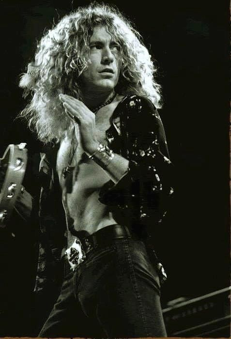 Robert Plant -- I don't know what it is about him  Jimmy Page, maybe because they're musical geniuses, but I'm in love.