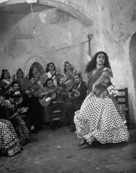 Granada Gypsies playing guitars for Gypsy dancer. Photograph by Dmitri Kessel. Granada, Spain, 1949.: