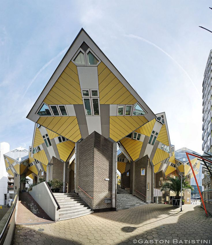 """Cube houses (Dutch: Kubuswoningen) are a set of innovative houses built in Rotterdam and Helmond in the Netherlands, designed by architect Piet Blom and based on the concept of """"living as an urban roof"""": high density housing with sufficient space on the ground level. Blom tilted the cube of a conventional house 45 degrees, and rested it upon a hexagon-shaped pylon. His design represents a village within a city, where each house represents a tree, and all the houses together, a forest…"""