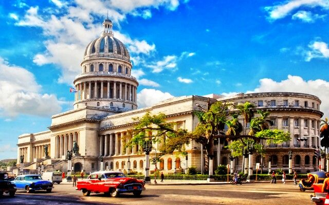 Landmark of Havana is uniquely Capitol....and old Americans cars.