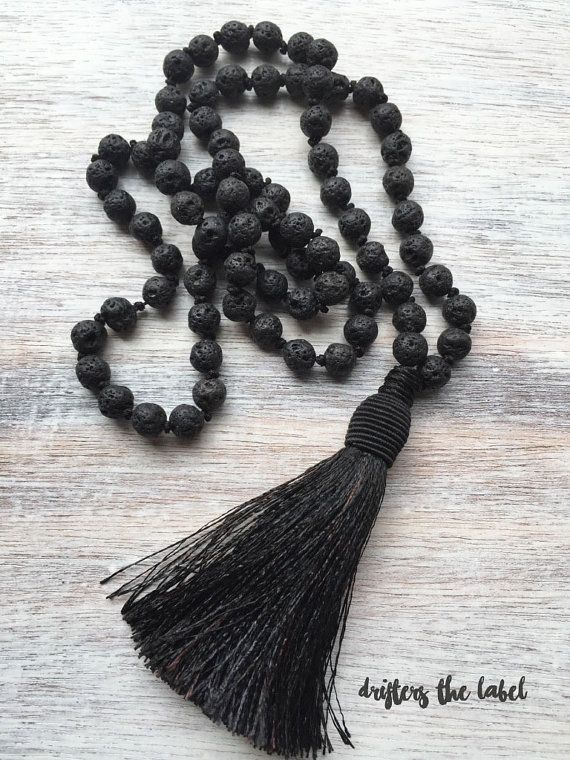 "This beaded necklace is handmade using stunning 8mm black lava beads finished off with a black coloured tassel. Necklace length (including tassel): 39"" Hanging length: 19""  ➳BLACK LAVA BEADS Lava is a a stone of protection and strength. A very grounding stone, black lava strengthens our connection to Mother Earth. The colour black represents strength and courage. The black tones in the beads offer protection."