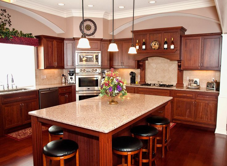 Cherry cabinets, cambria counters, arched soffits ...
