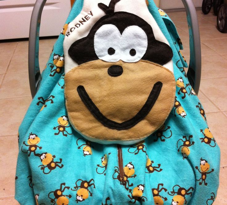 Fun Infant Car Seat Cover- with pockets and pacifier/toy holder