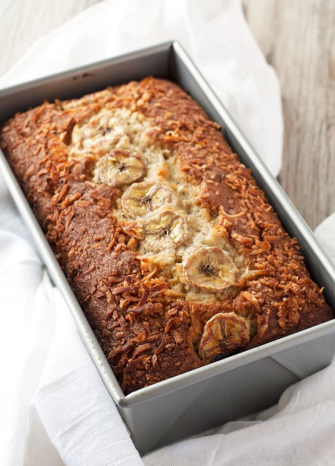 This coconut banana bread is made with coconut milk, shaved coconut and topped with sliced bananas and even more coconut - moist, delicious, and tropical!