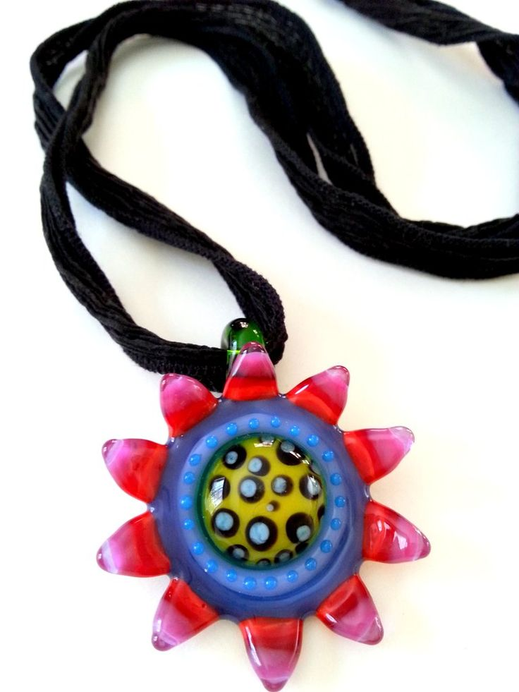 This is the magical focal pendant that Lori Anderson sent me. No wonder she hoarded this one. The colors are spectacular and like nothing I've ever worked with. And so I began auditioning simple cording fr the neckline. First one is black silk.