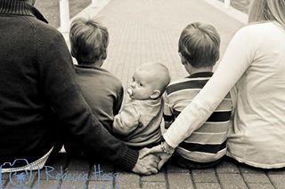 Great Family Photo by Rebecca Hess Photography. I love the baby looking at the photographer. So cute