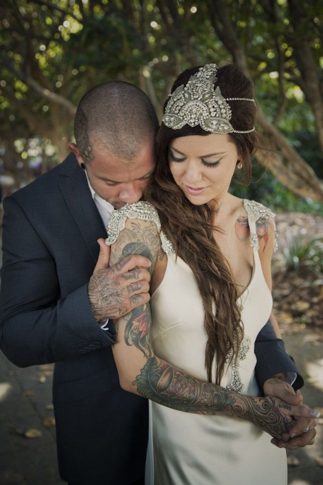 beautiful tattooed couple- photos by  peppermintlane on rockandrollbride. Vintage, headpiece, silk dress, mermaid waves