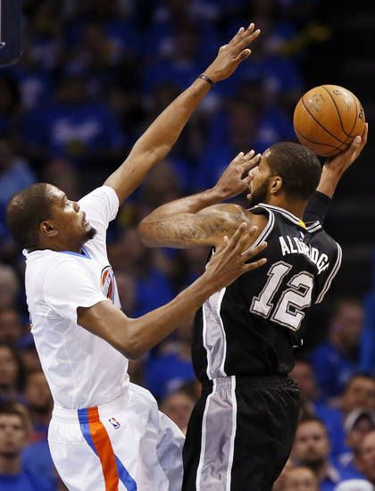 San Antonio's LaMarcus Aldridge (12) works against Oklahoma City's Kevin Durant (35) during Game 3 of the Western Conference semifinals between the Oklahoma City Thunder and the San Antonio Spurs in the NBA playoffs at Chesapeake Energy Arena in Oklahoma City, Friday, May 6, 2016. Photo by Nate Billings, The Oklahoman