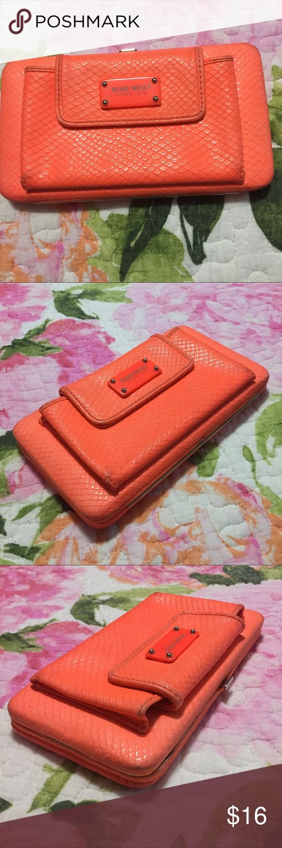 ❗️SALE❗️Nine West Orange Wallet Orange wallet with snake like print. Outside pocket. Gray color on inside, with five card slots, one zipper pocket and two folds on the side. On inside of pockets it has a high heels pattern. Good condition with signs of wear. Chain missing. Nine West Bags Wallets
