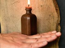 Moonshine - Bottle shaped brown beeswax candle