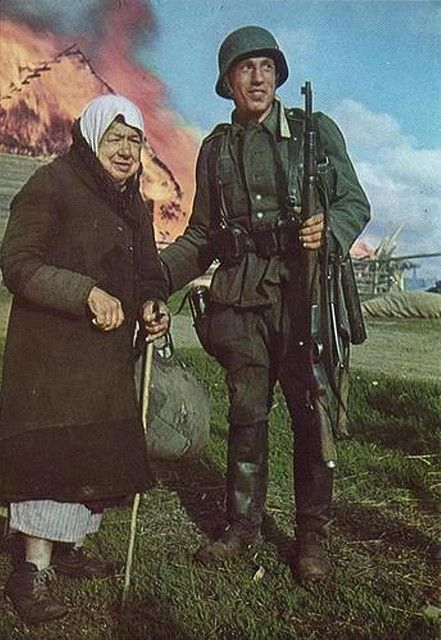 German soldier with a Russian elderly woman after the red army retreat in the region (Ukraine 1941):