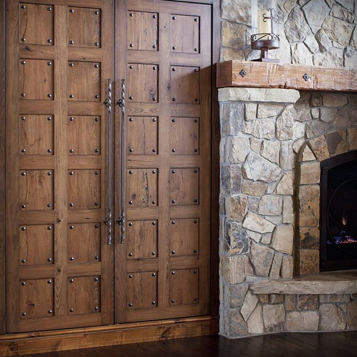 Great Rustic Wood Mantel With Big Castle Style Doors