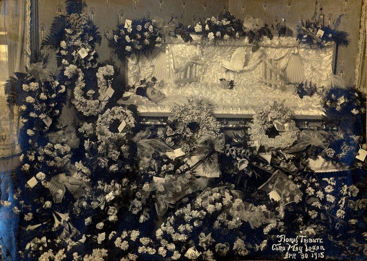 Cora May Reddick Dancy Logan in Coffin Surrounded by Funeral Flowers, Albumen Print, 30 April, 1915