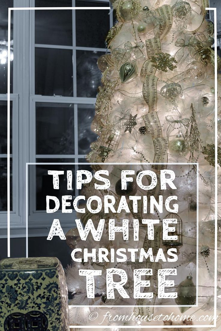 """This winter wonderland white Christmas tree is GORGEOUS! I love the secret to adding """"snow"""" to it, and the silver and gold accents are beautiful."""