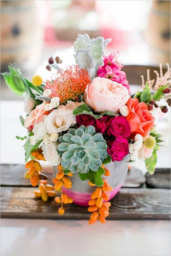 hot pink and orange centerpiece @weddingchicks
