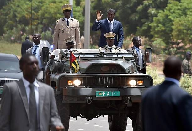 Togo's President Faure Gnassingbe (R) waves from a vehicle during the celebration of the 55th anniversary of the country's independence outside the presidential palace in Lome on April 27, 2015. (Getty)
