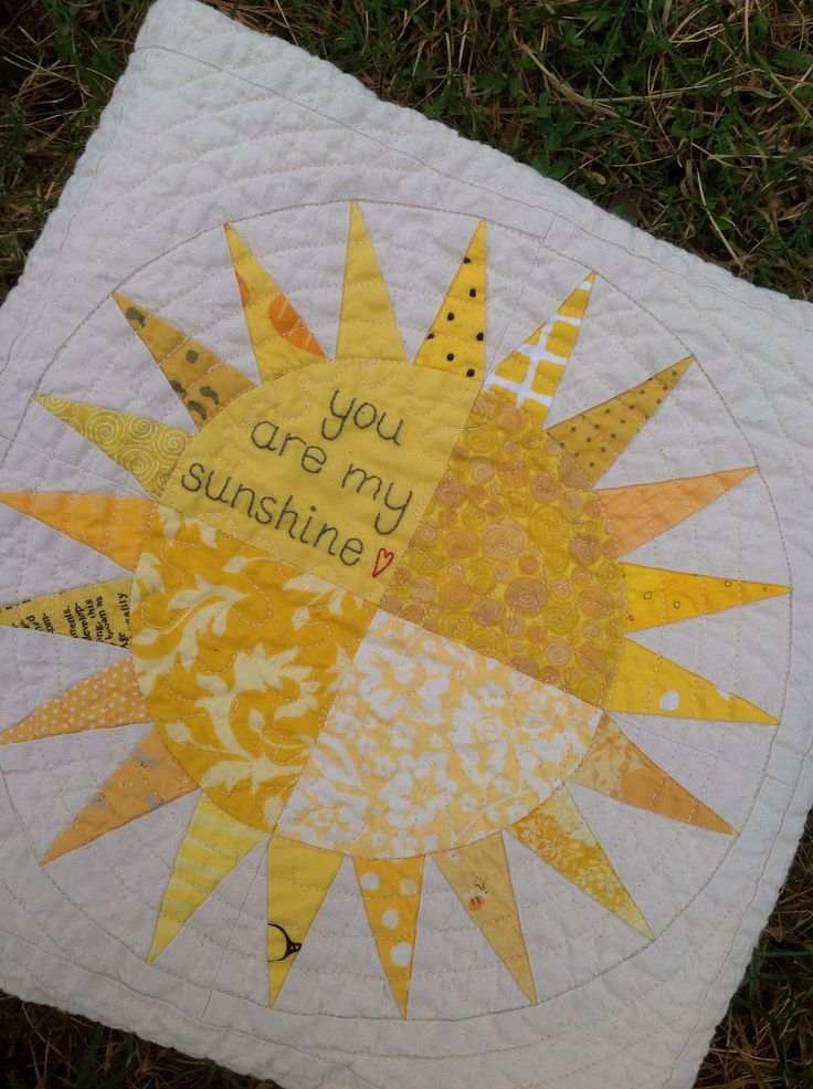https://flic.kr/p/eiv2ix | Baby quilt custom made. | Detail of the sun with embroidery.