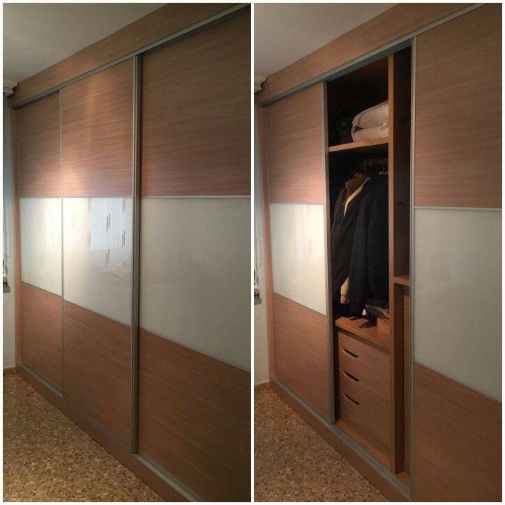 Frente e interior de armario fabricados en melamina y cristal lacobel, puertas con guías correderas