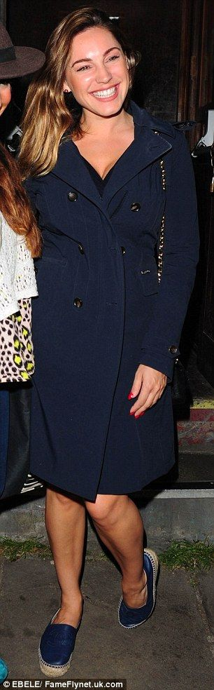 Dressed down: Kelly covered up in a navy coat and opted for a pair of flat Chanel espadrilles