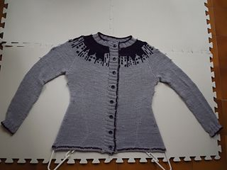 I love this cardigan!!! And I feel as if I've taken my knitting a step higher. I couldn't be happier.  I kept the original chart but I am not following the pattern. I intend to knit it flat, withou...