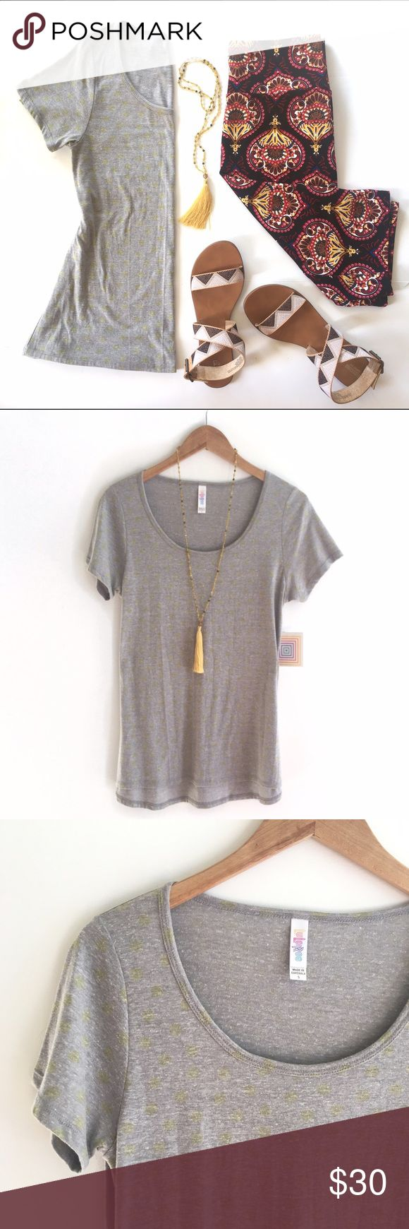 Dot Print Heather Scoop Neck T, NWT! Soft heather jersey with a subtle dot print in yellow. Cute for summer adventures in the park! Perfect paired with your fav denim and works great for print mixing. Sz Small Classic T by LuLaRoe runs slightly larger than other brands. Listing for T only but outfit shown available. Or request one styled especially for you from my mix or vintage and new ! LuLaRoe Tops Tees - Short Sleeve