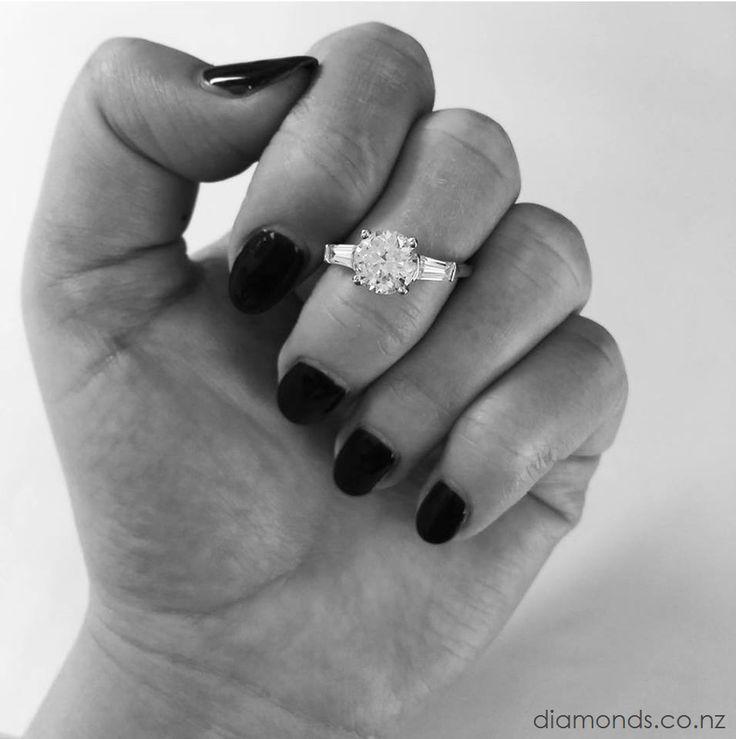 THREE STONE / Round Diamond & Tapered Baguette Sides www.diamonds.co.nz