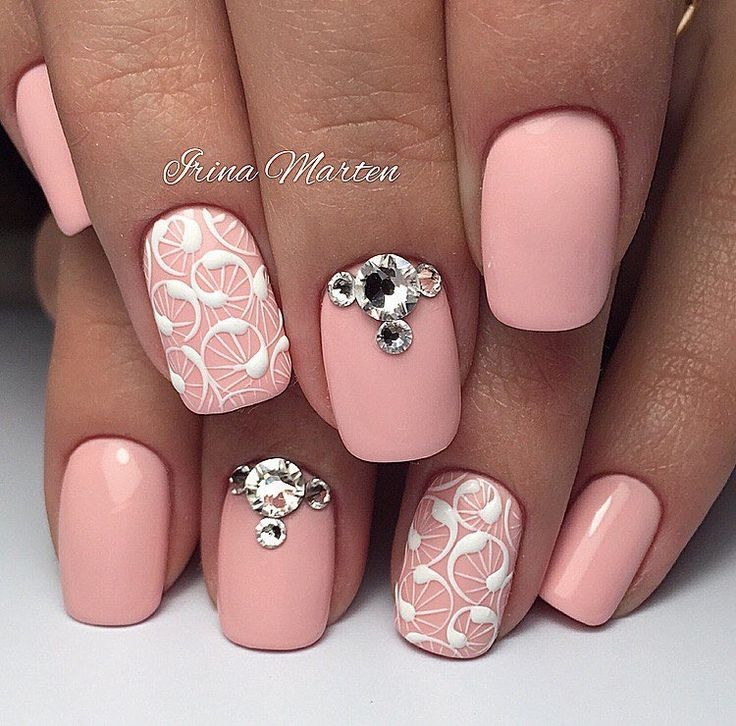 This is one more variant of pink manicure, which is made on the lenghthened half square nails. Use the decorations ...