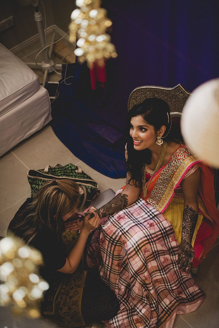 Reshma + Aniket: A Chic Indian Wedding in Sydney and Melbourne - Marathi wedding - henna night - mehendi night - yellow pink and orange Chamee and Palak lehenga #thecrimsonbride