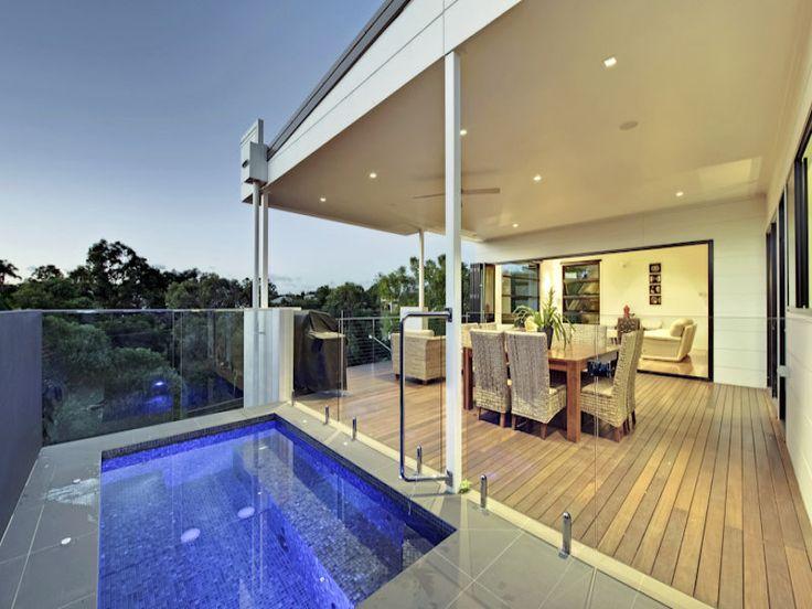 Indoor-outdoor outdoor living design with balcony & ground lighting using tiles - Outdoor Living Photo 1207471