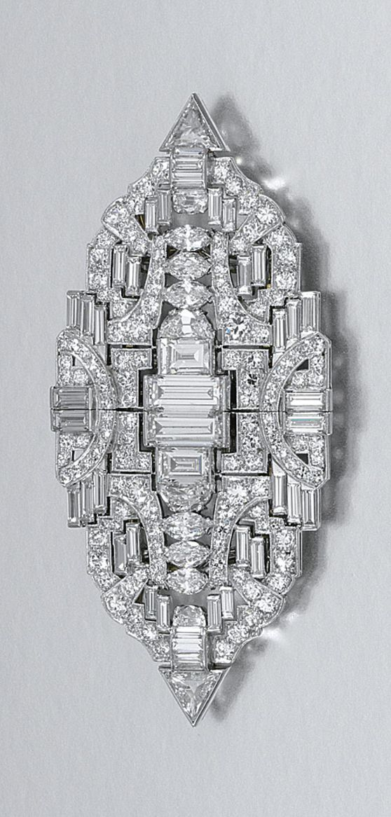 DIAMOND DOUBLE CLIP BROOCH, 1930S.  Of open work geometric design, set with circular-, step- and single-cut, marquise-, triangular- and demi-lune shaped, and baguette diamonds, detachable clip fittings