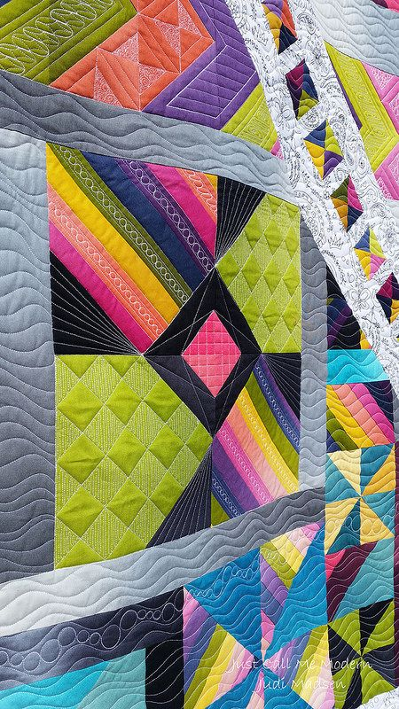 The waves in the background are really fun and I guess you can say that this quilt is a little more modern than my traditional approach to quilt design.
