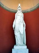 This is the statue of a woman named Minerva, which was part of a statue called Font de l'Aurora. The original sculpture had her on a chariot pulled by two horses representing the sun and the moon. It was dimantled because it was facing its back to Gracia, and example of how much the Spanish community values these pieces of art.