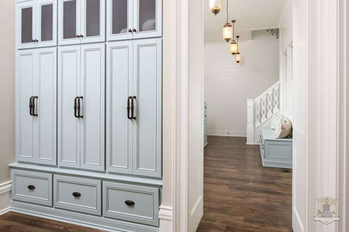 I love the look of these mud room lockers with shoe storage below and a place for diaper bags/purses up above.